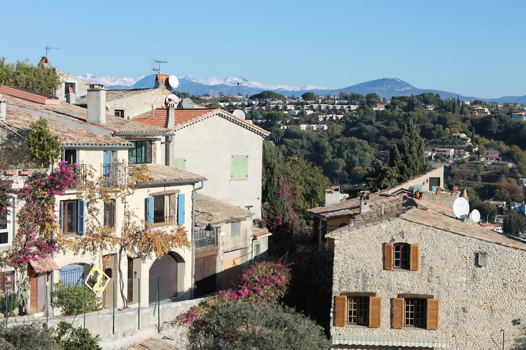 View of our lovely village street from the Terrace, notice the mountains in the distance