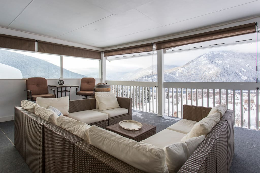 The covered deck provides a great spot to enjoy the views, year round