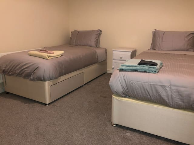 Second bedroom with super king size bed split to make two 3X6.3inch single beds with 300 Thread count Egyptian cotton sheets