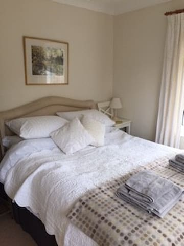 The main bedroom has a lovely comfy bed