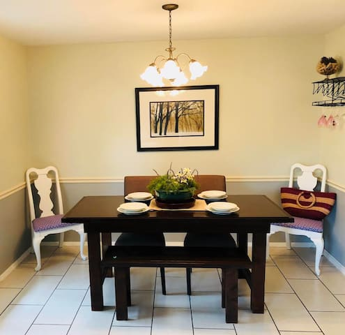 dining room and fully furnished kitchen with breakfast nook
