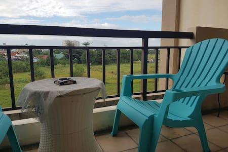 2 Bedroom; Fully Furnished Condo w/ veranda - Las Pinas