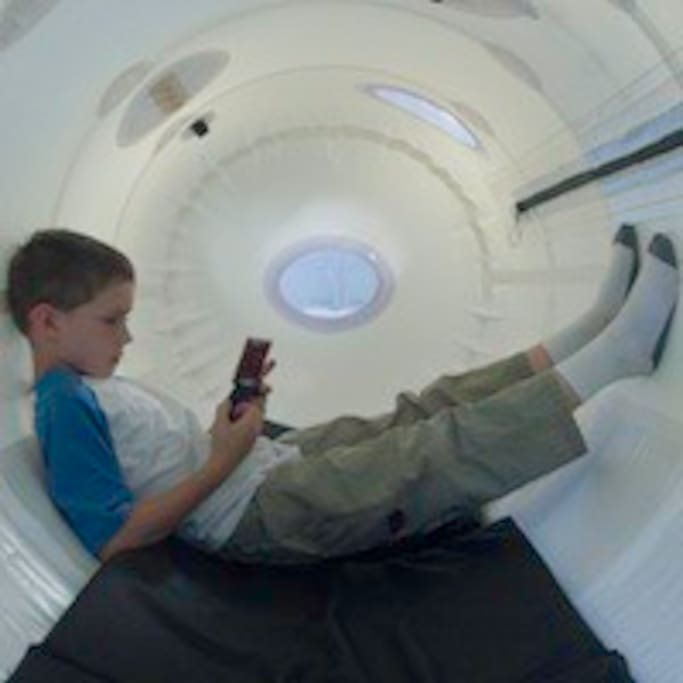 An adult supervising a child during the therapy session, called a dive, fits comfortably in this mild pressure hyperbaric chamber, which is designed for both the clinic and the home use.