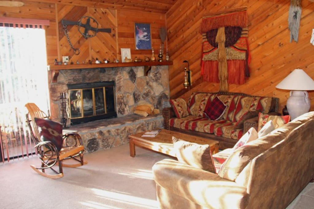 Mammoth Condo Rental Snowflower 45 - Living Room Fireplace Hearth and Outside Deck Access