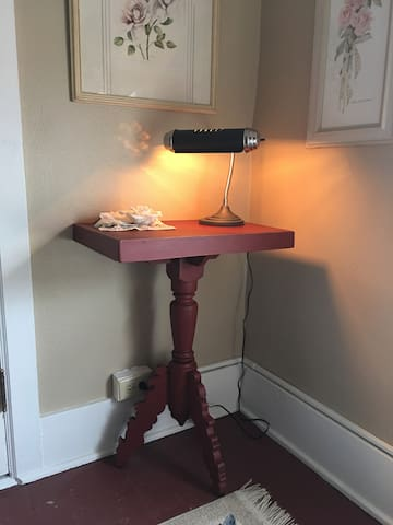 Rose's Room has a small table and lamp near an outlet convenient for charging your devices.