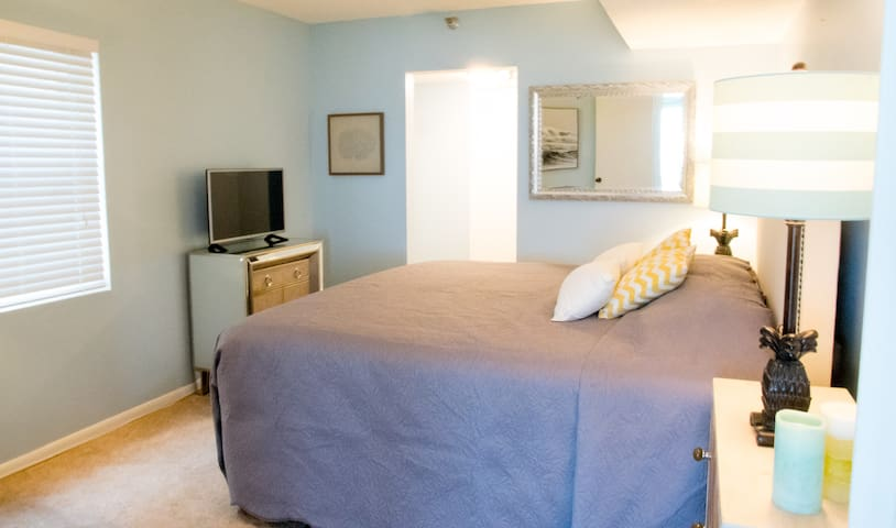 Master bedroom with our favorite king bed ever. It's our #1 most mentioned compliment, after the ocean-front location