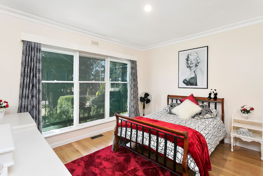 Large main bedroom with great garden views