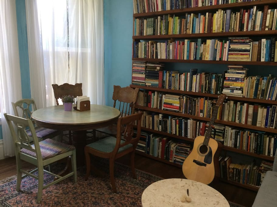 Sunny living/dining room with library