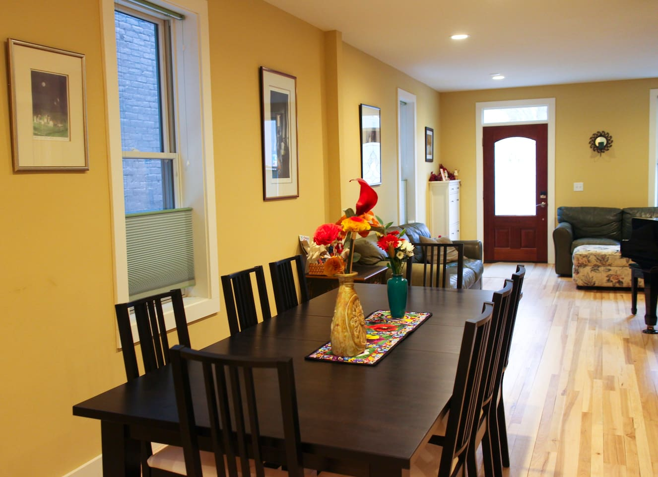 First floor living and dining areas have beautiful wood floors, and natural light.  The grand piano beckons you to play. Make yourself at home!