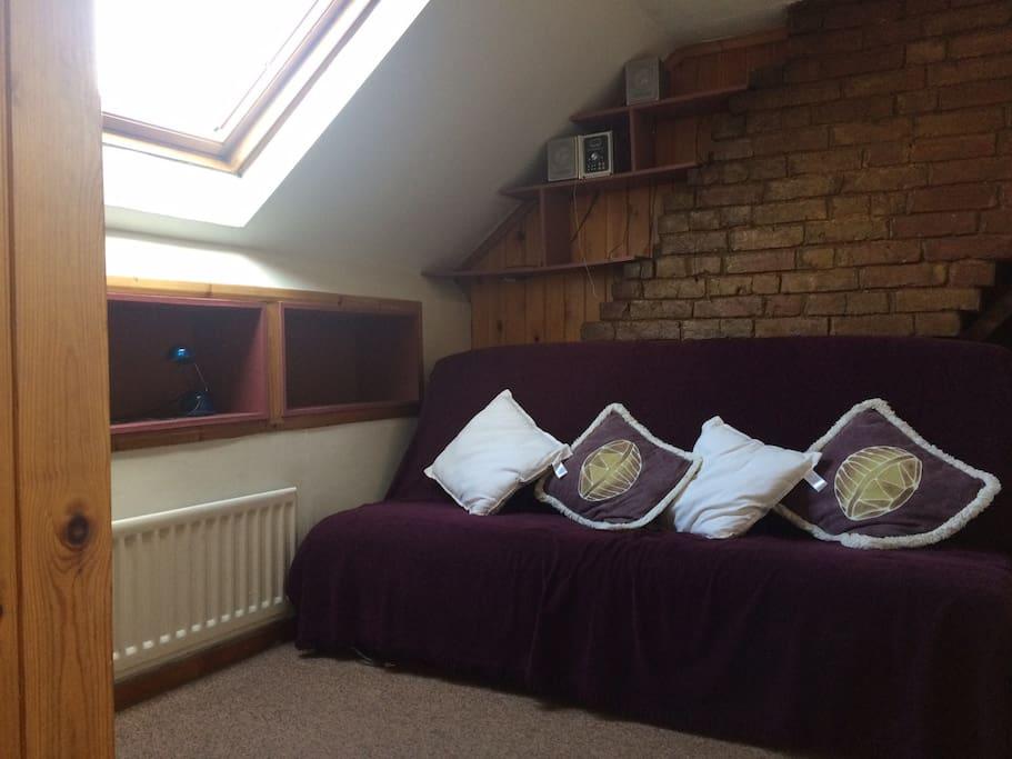 Second floor Bedroom 1.  Double Sofa bed, sleeps 2.  TV.