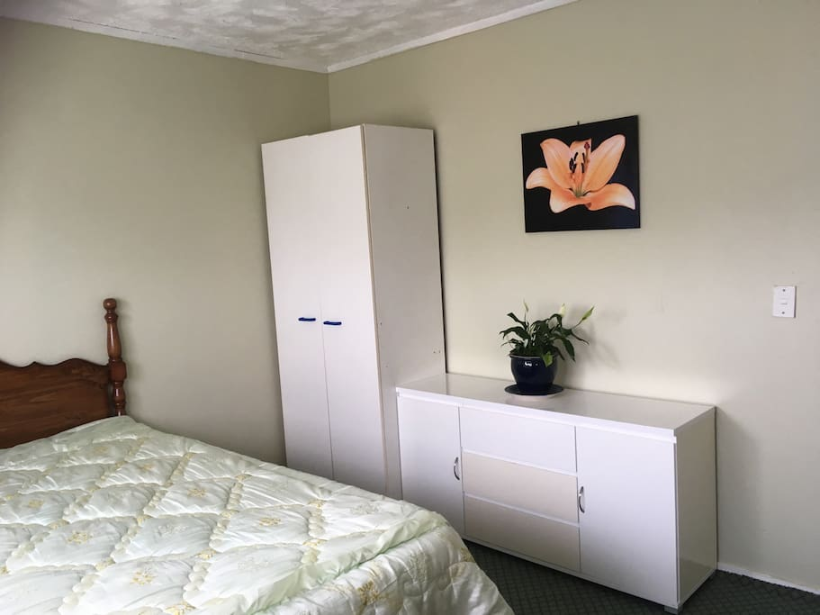 Bedroom- fully furnished with queen bed, draws, dresser and wardrobe.
