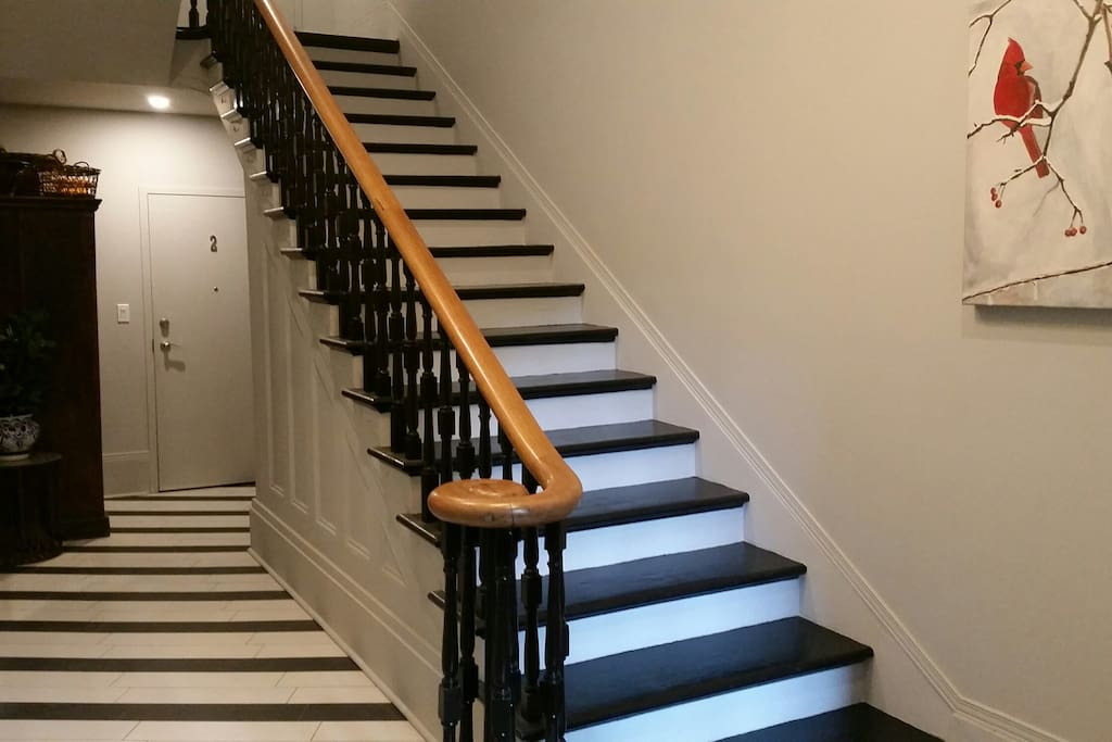 Boutique hotel feel in the grand yet funky foyer with original 1857 stairs.