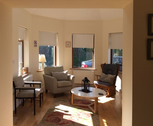 Bright sunroom/sitting room! A chair for father bear, mother bear, baby bear, Goldilocks and visitors!
