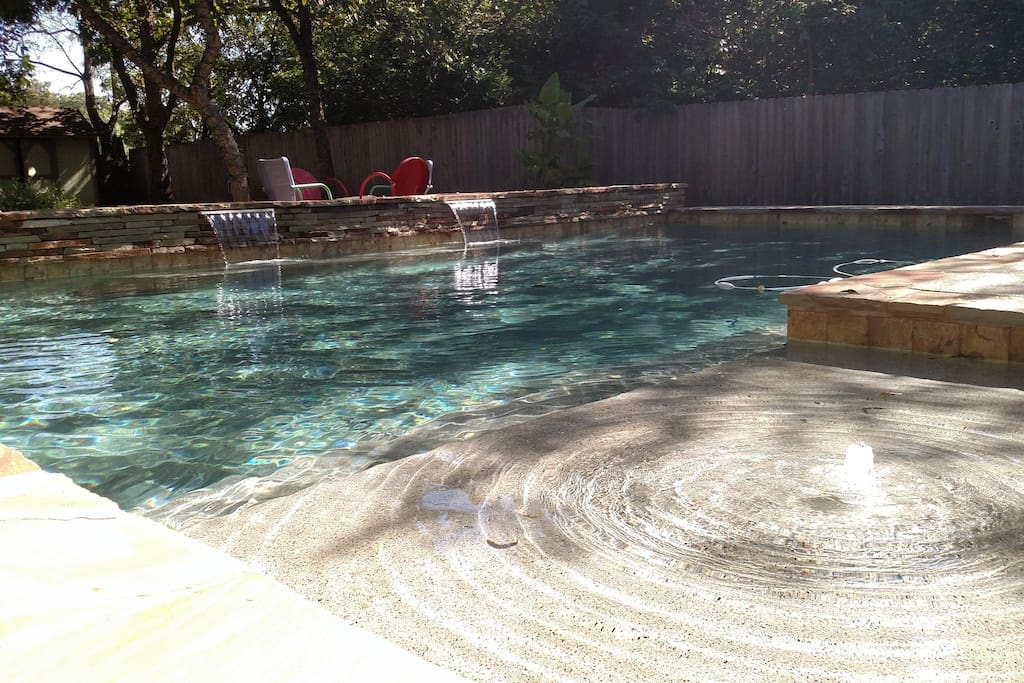 Pool has 2 waterfalls, a shallow lounge area and benches along the perimeter.