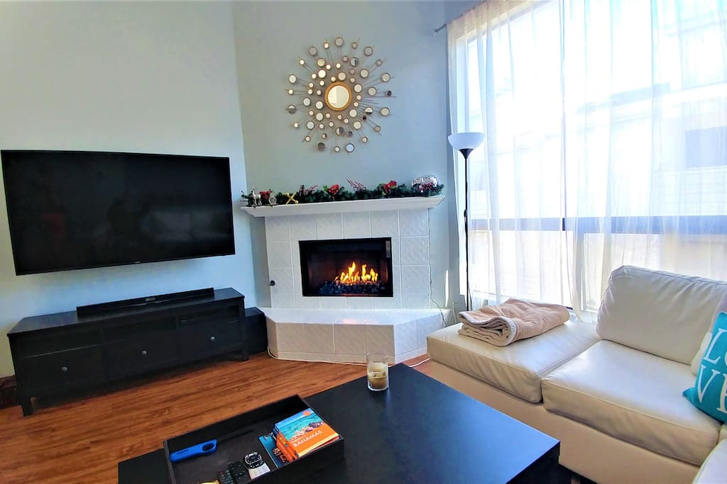 65in TV and cozy fireplace