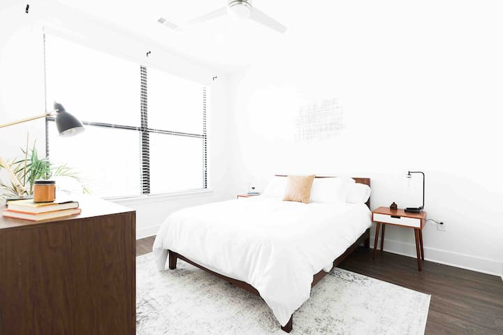 The bedroom has tons of natural light and a very comfy queen sized bed.