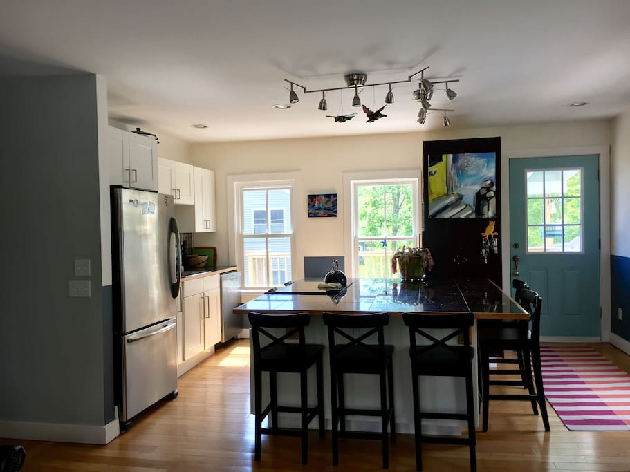 Fully outfitted kitchen with stone, refrigerator, dish washer, coffee maker, pots & pans, flatware, silverware, etc.