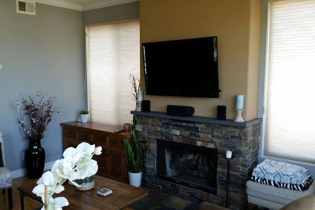 """living room with 50"""" high definition smart TV with HomeTheatre system"""