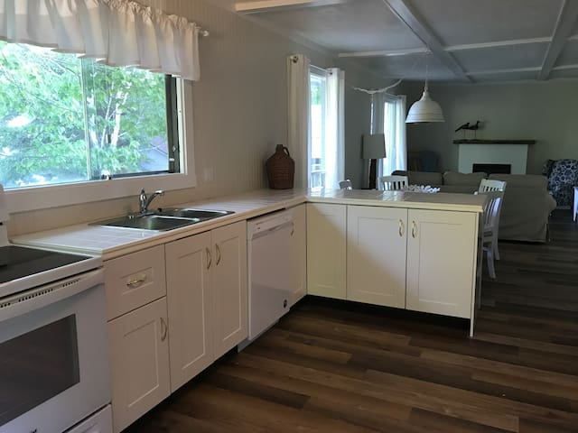 Full kitchen with stove, fridge, microwave and dishwasher