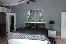 Master bedroom with king size bed  His and hers closets