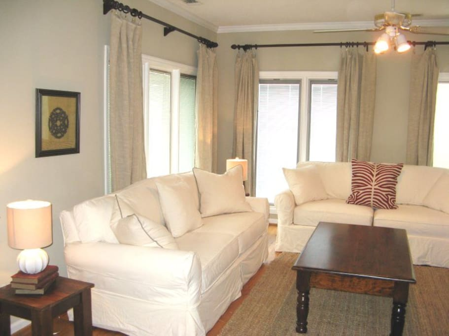 Large great room with comfortable living area and TV with DVD player