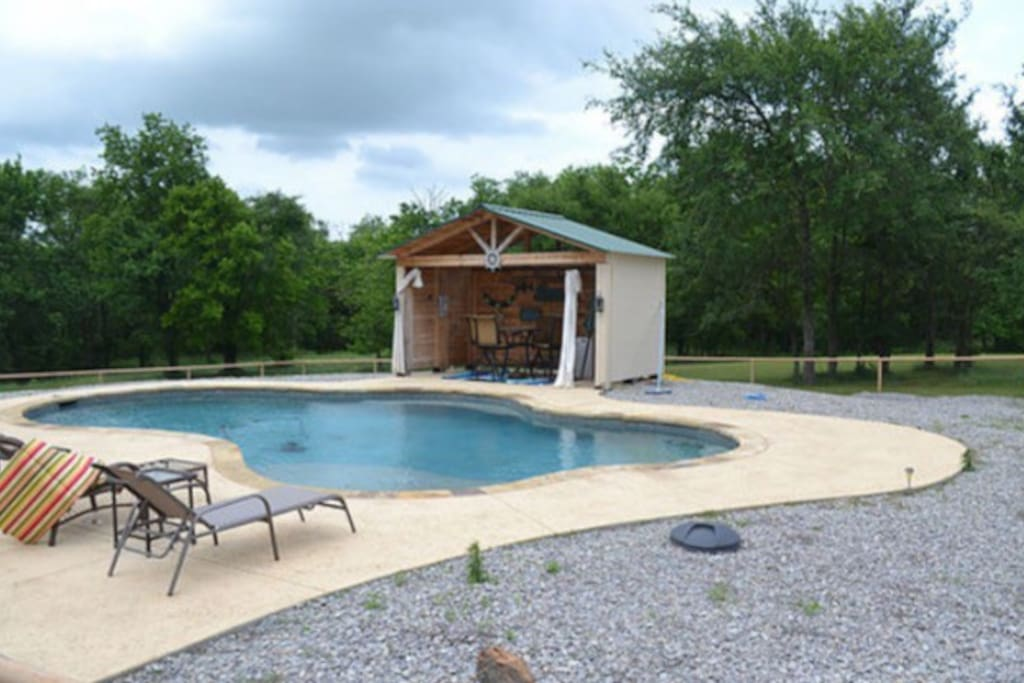 Full size pool with tiki bar