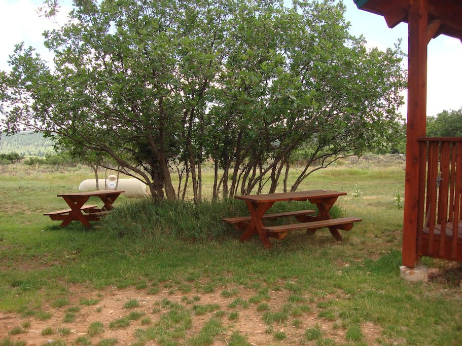 Picnic tables in front of cabin 3
