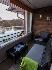 Studio with Balcony and Pool overlooking a lake! - Lägenhet