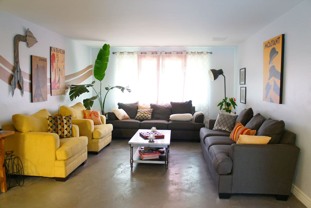 The living room is the best for hanging out, entertaining guests, or just taking a nap on any of the super comfy couches