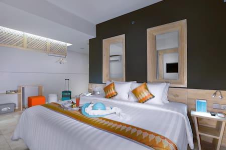 Dmax Hotel - Deluxe Room