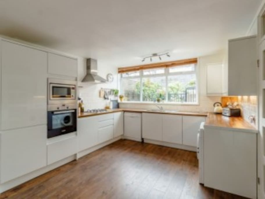 Kitchen has gas hob, electric oven, microwave, fridge freezer, dishwasher and washer/dryer.
