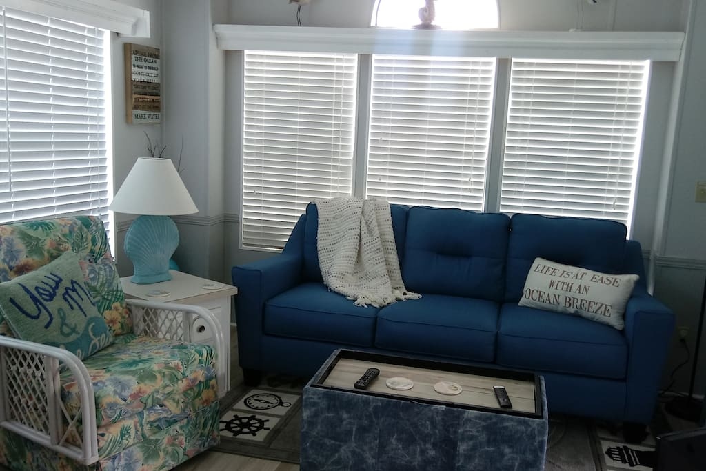 The living room has a new queen size sleeper sofa to sleep a 3rd or 4th person.
