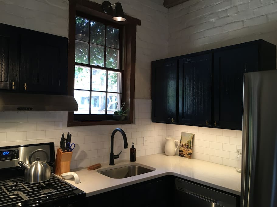 The kitchen is newly renovated and has quartz countertops and stainless appliances.