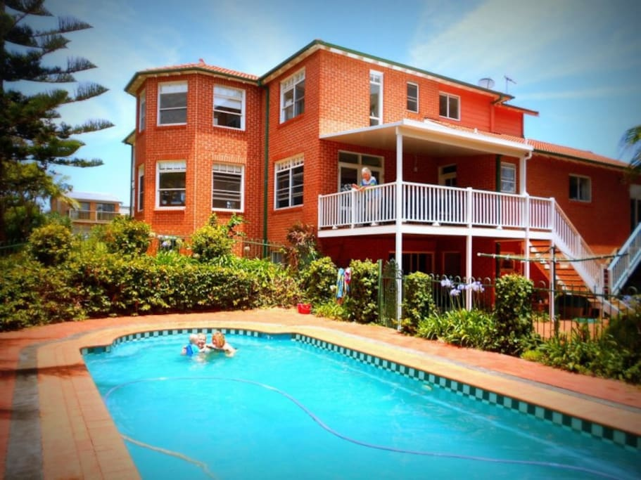 The ground floor flat has direct access to the pool