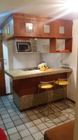 Sala de estar com cozinha conjugada