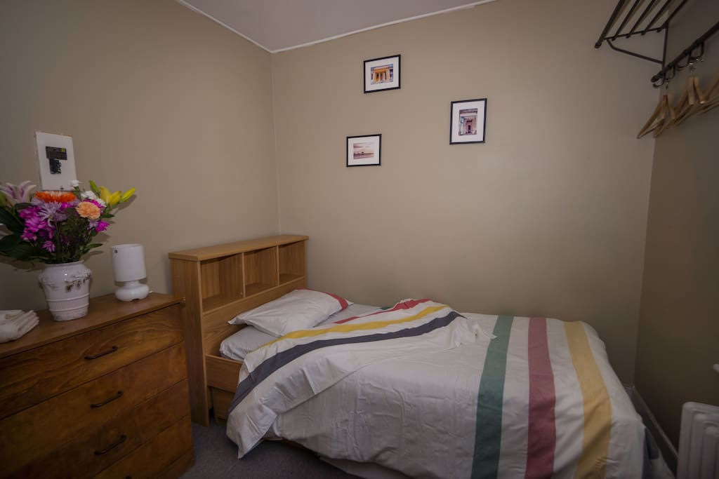 The furnished room is supplied with bedding and towels -- ideal for long-stay students!