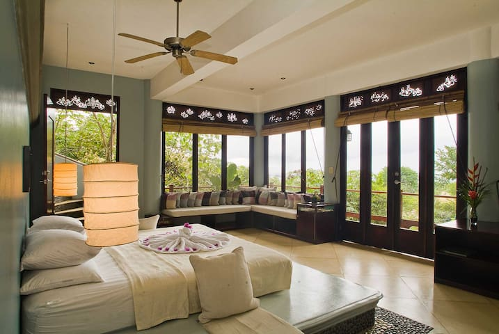The master suite is large with a private balcony and huge views.