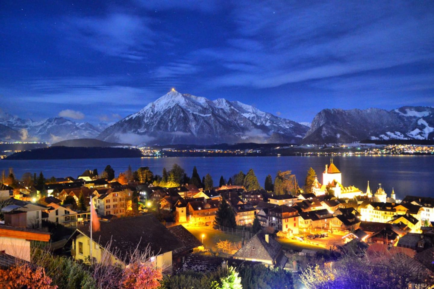 Romantic night view, overlooking Oberhofen, the castle, the lake and to the mountains.