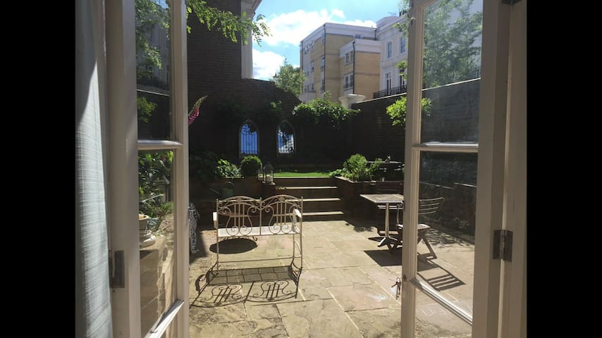 From the living room, into the private garden
