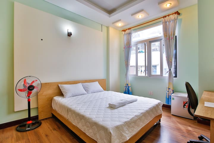 Bright cozy home in HCMC central Private Room 302