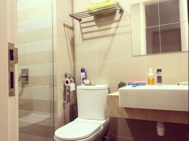 Your bathroom and shower with clean and fresh towels.