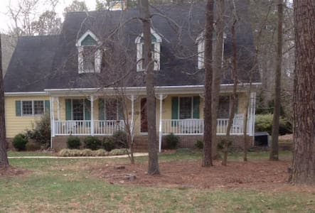 2 bedrooms w/queen beds and a sitting room w/twin. - Wake Forest
