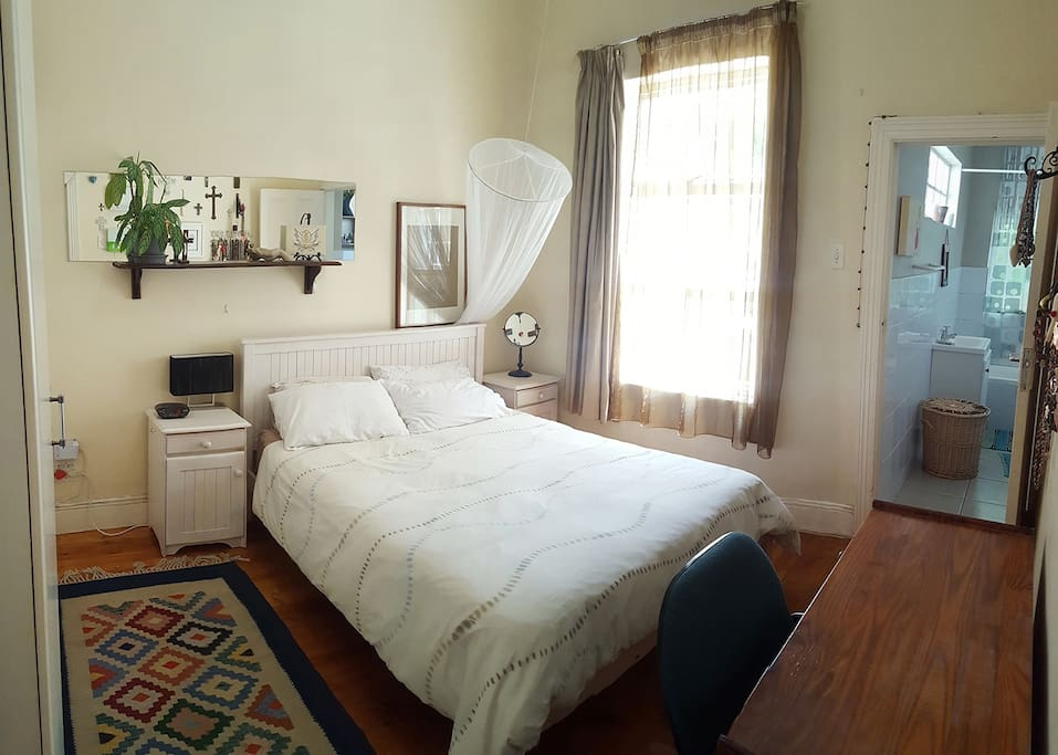 Bedroom 1 with king sized bed & ensuite bathroom (bath & shower)