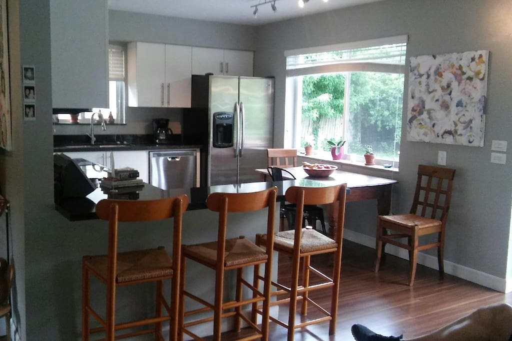 Recently remodeled kitchen has black granite counter tops and breakfast bar. all appliances are stainless steel.