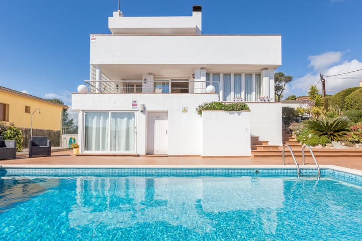 Spacious holiday villa with private swimming pool and various terraces in Blanes