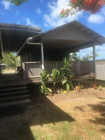 bush and beach house