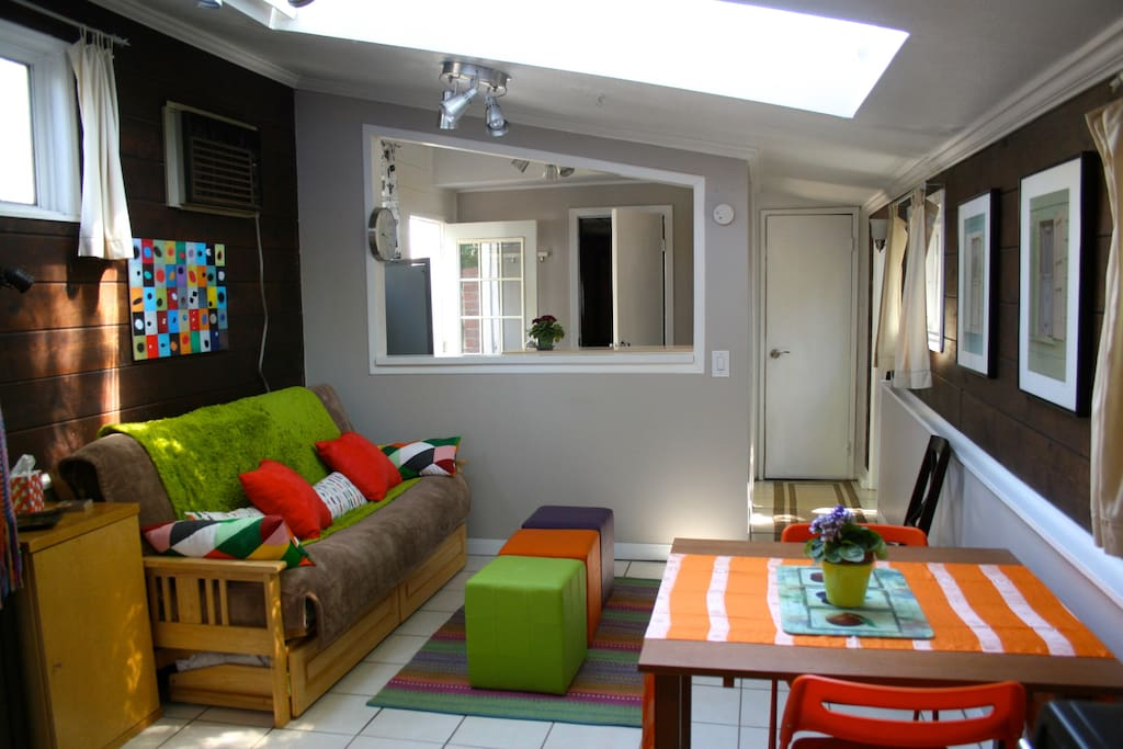 Front sitting room, with skylight, kitchen area, bath.