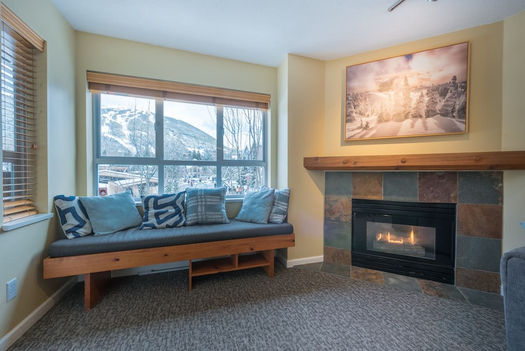 Living Room 2 - Enjoy the stunning mountain view while sitting next to the fireplace