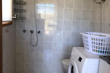 outdoor laundry, shower and toilet. Washing machine is brand new