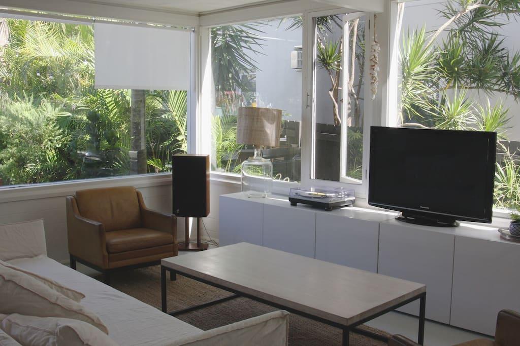 Light filled living room flows onto large garden